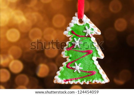 Gingerbread Christmas tree, glittery gold background
