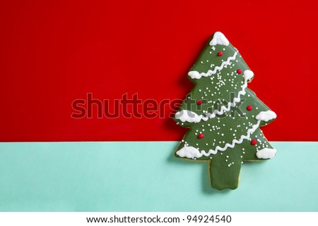 Gingerbread Christmas tree on red background