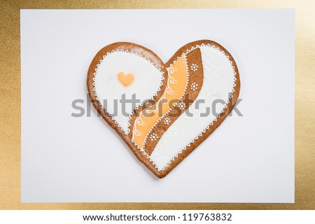gingerbread cookie heart on white background in golden frame #119763832