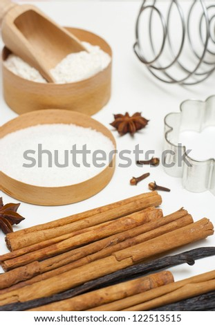 gingerbread cookie ingredients on white kitchen table