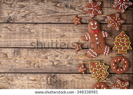 Gingerbread cookies christmas composition on vintage wooden table background frame. Top view. Rustic style. #348338981