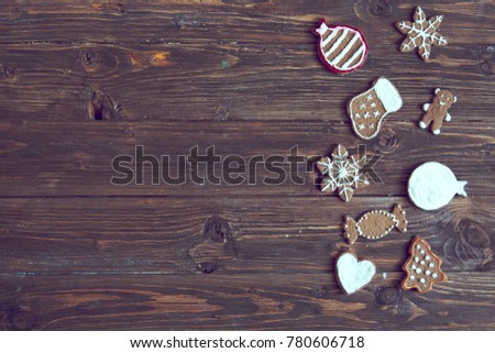 Gingerbread cookies hanging over wooden background. Top view. #780606718