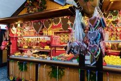 Gingerbread cookies in Christmas market, Germany in Europe in winter. German Night street Xmas and holiday fair in European city or town, December. Gendarmenmarkt in Berlin