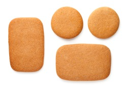 Gingerbread cookies in shape of rectangles and circles isolated on white background. Top view