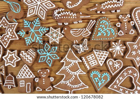 Gingerbread cookies on wooden background. Christmas decoration.