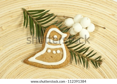 gingerbread cookies on wooden plate - stock photo