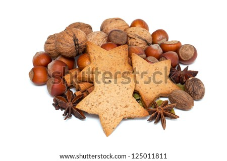 gingerbread cookies with cinnamon, anise and nuts on white background