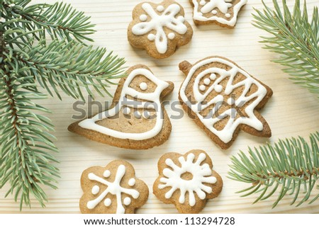 gingerbread cookies with pine branch on wooden
