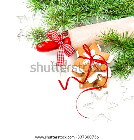 Gingerbread cookies with red decorations on white background. Christmas composition #337300736