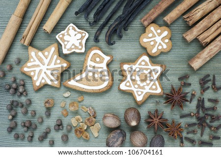 gingerbread figurines and dessert spices, wooden table background