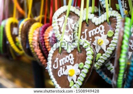 """Gingerbread heart in munich typical tourist souvenir from bavaria city and oktoberfest. German text is reading """"i like you"""" in traditional bavarian slang language """"i mog di"""""""