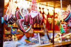 Gingerbread Hearts at German Christmas Market. Nuremberg, Munich, Berlin, Hamburg xmas market in Germany. On traditional ginger bread cookies written I love you called Lebkuchenherz in German