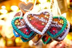 Gingerbread Hearts at German Christmas Market. Nuremberg, Munich, Fulda, Berlin, Hamburg xmas market in Germany. In German language Merry Christmas.