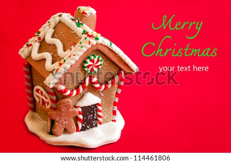 Gingerbread house on red background.