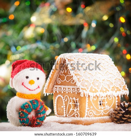 gingerbread house over on the snow and lovely handmade snowman