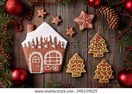 gingerbread house stars and fur trees cookies christmas composition in new year decorations frame on
