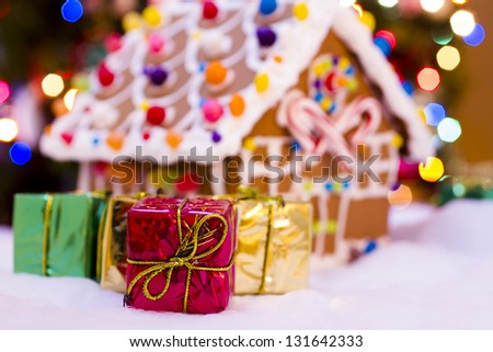 Gingerbread house with small presents.