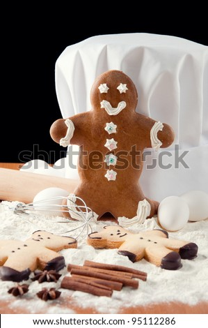 Gingerbread man, chef's hat, food ingredients and kitchen utensils