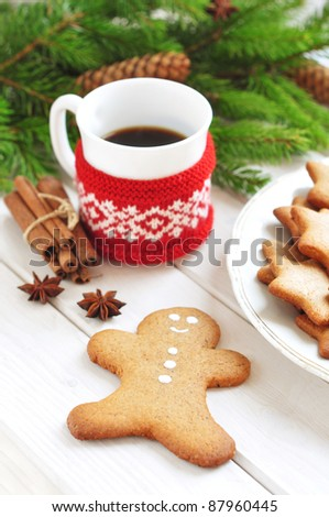 Gingerbread man cookie and cup of coffee