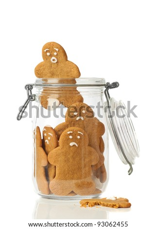 Gingerbread man escaping the jar of cookies on white background