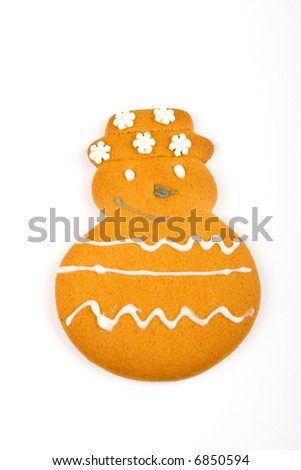 Gingerbread snowman against a white background