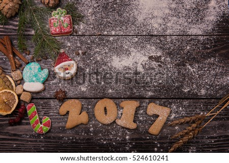 Gingerbreads for new 2017 year holiday on wooden background, xmas theme #524610241