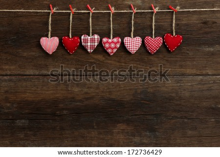 Gingham Love Valentine's hearts natural cord and red clips hanging on rustic driftwood texture background, copy space Stock fotó ©