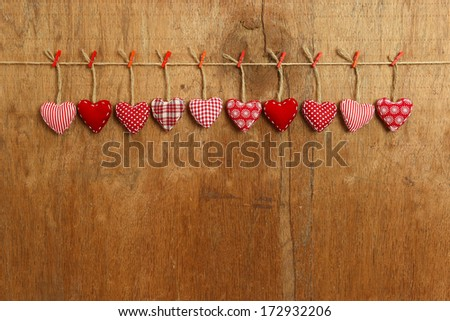 Gingham Love Valentine's hearts natural cord and red clips hanging on rustic plywood texture background, copy space Stock fotó ©