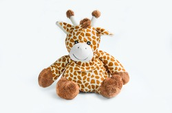 Giraffe plush doll isolated on white background with shadow reflection. Giraffe plush doll on white background. Colorful plush toy. Colored stuffed toy-giraffe. White brown giraffe
