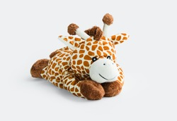 Giraffe plush toy isolated on white background with shadow reflection. Giraffe plush doll on white background. Colorful plush toy. Colored stuffed toy-giraffe. White brown giraffe