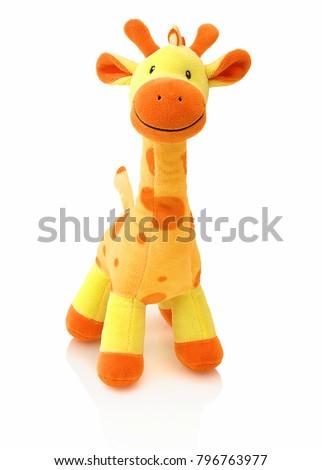 Giraffe plushie doll isolated on white background with shadow reflection. Giraffe plush stuffed puppet on white backdrop. Colored stuffed giraffe toy. Yellow giraffe.