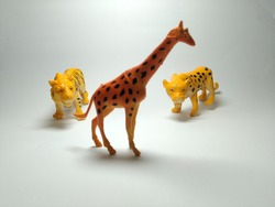 Giraffe, Tiger and Cheetah Plastic Toy - Miniature Plastic Toy Animals on white background