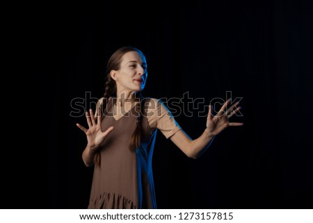 Girl Actress on stage plays emotions in blue theatrical light #1273157815