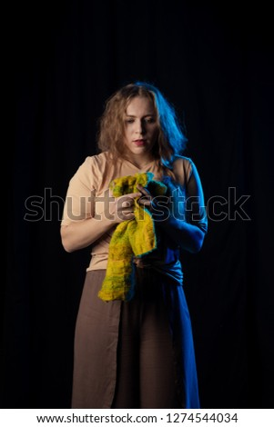 Girl Actress on stage plays emotions in blue theatrical light #1274544034