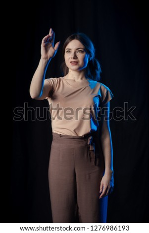 Girl Actress on stage plays emotions in blue theatrical light #1276986193