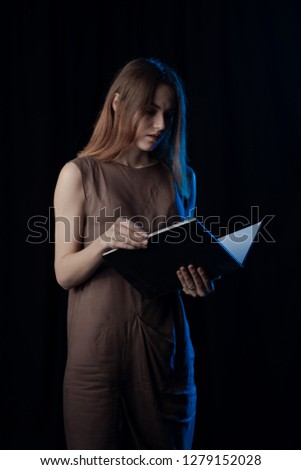 Girl Actress on stage plays emotions in blue theatrical light #1279152028