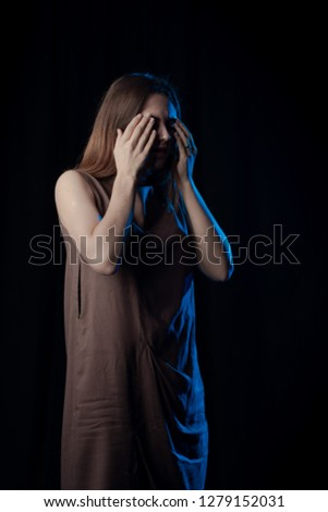 Girl Actress on stage plays emotions in blue theatrical light #1279152031