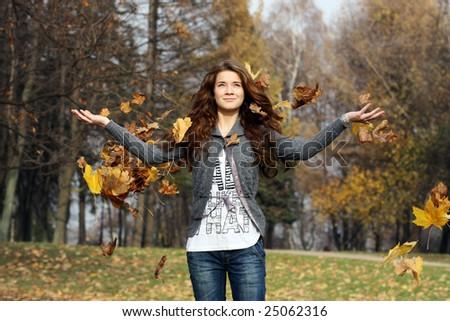 girl among flying leaves