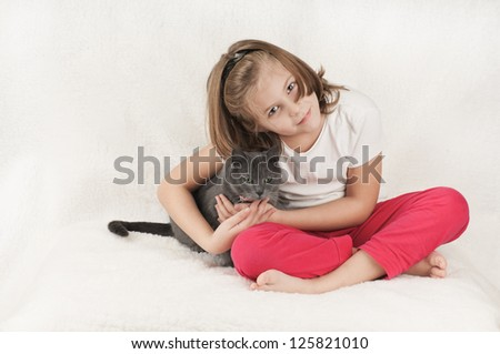 girl and a cat on the bed