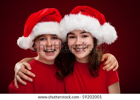 Girl and boy as Santa Claus