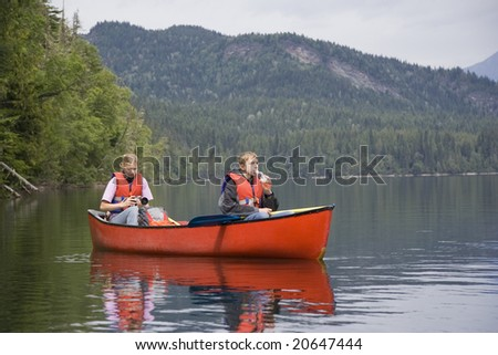 Girl and boy canoeing, Canada