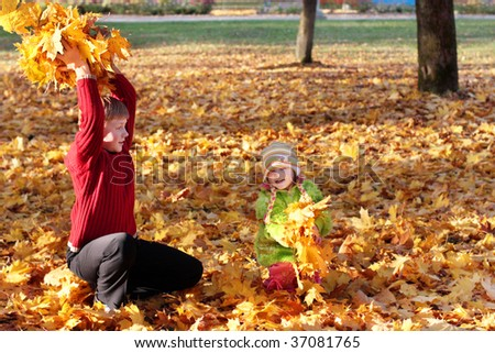 girl and boy  in autumn park