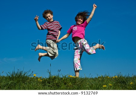 Girl and boy jumping - stock photo