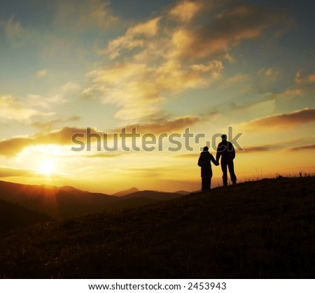 Girl And Boy Silhouette On The Sunset Background Stock