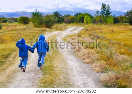 girl and boy standing or running on the road