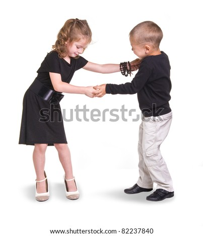 girl and boy study to dance.childrens on a white background