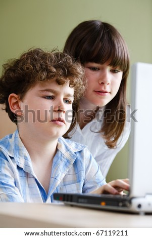 Girl and boy using computer at home #67119211