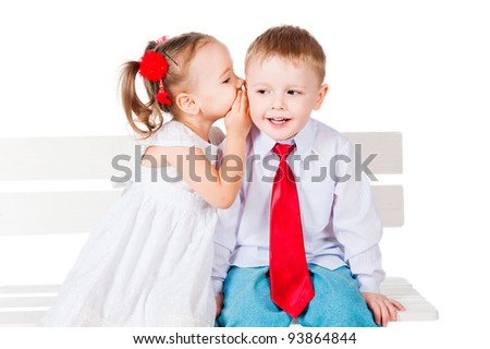 Girl and boy whispering