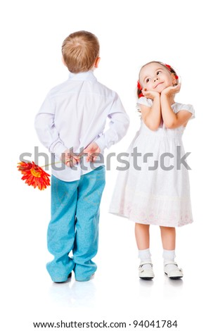 girl and boy with a flower