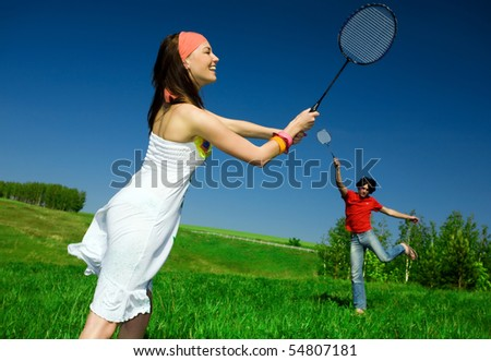 Girl and boy with rackets